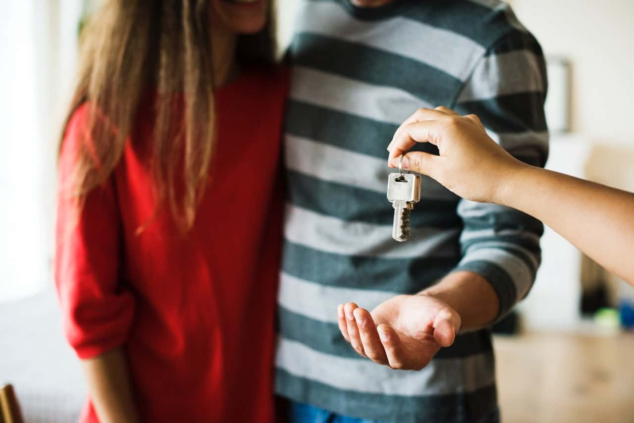 Couple receiving a key of a new home